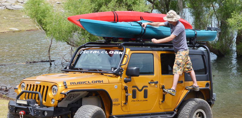 people putting kayak on white jeep jk wrangler