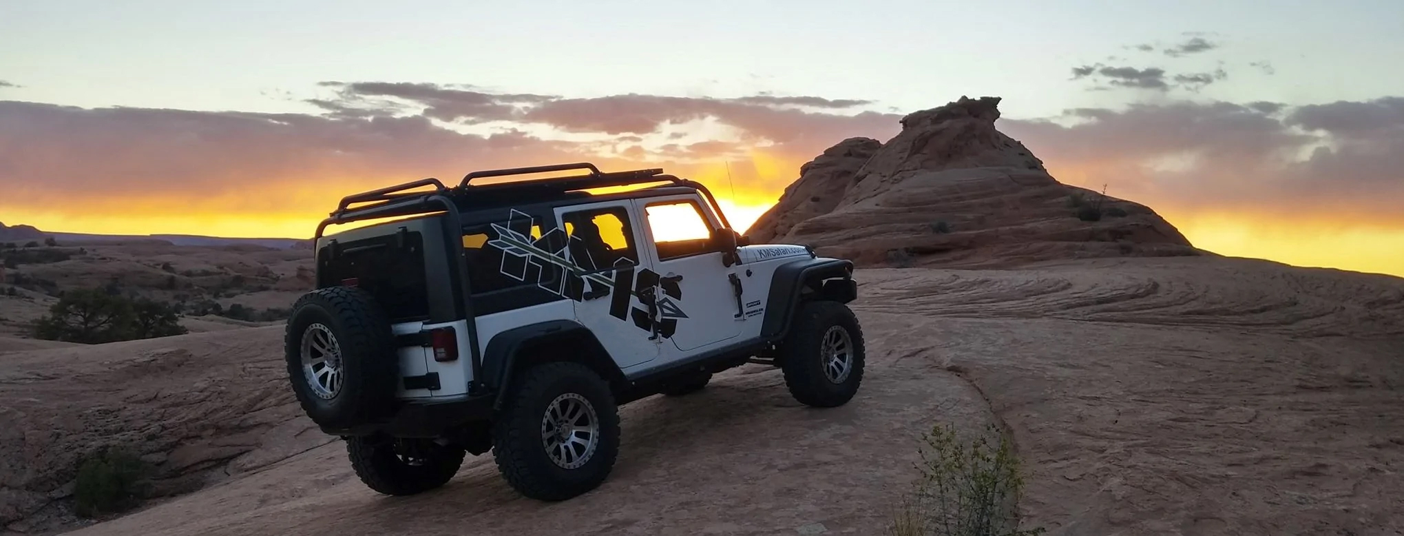 jeep with kms rack on desert mountain