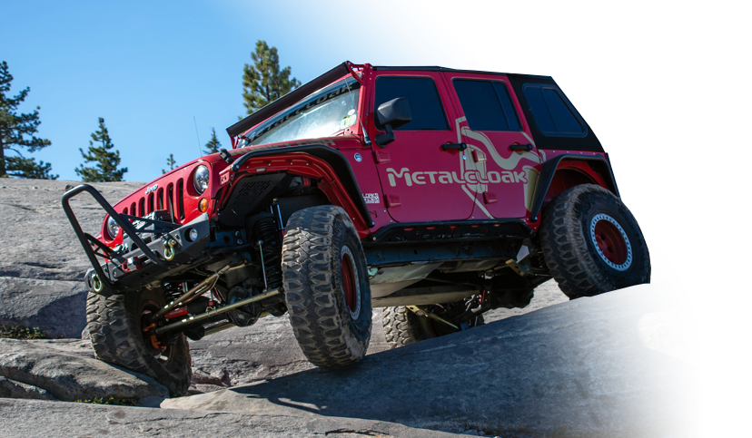 red MetalCloak Jeep JK Wrangler on rock trail