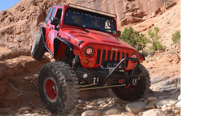 red MetalCloak Jeep JK Wrangler on rock trail