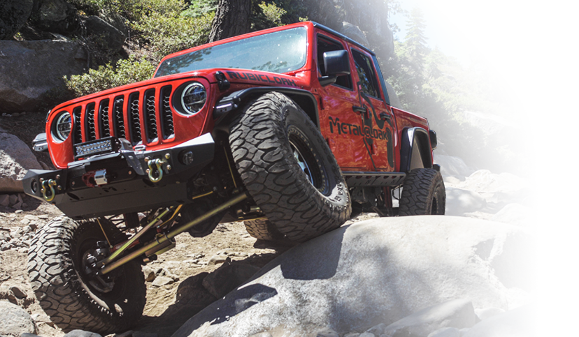 red MetalCloak Jeep JT Gladiator on rock trail