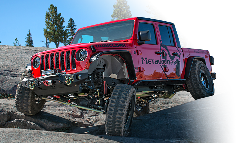 red MetalCloak Jeep JT Gladiator on banked dirt trail