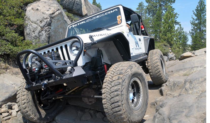 white MetalCloak Jeep TJ Wrangler on rock trail