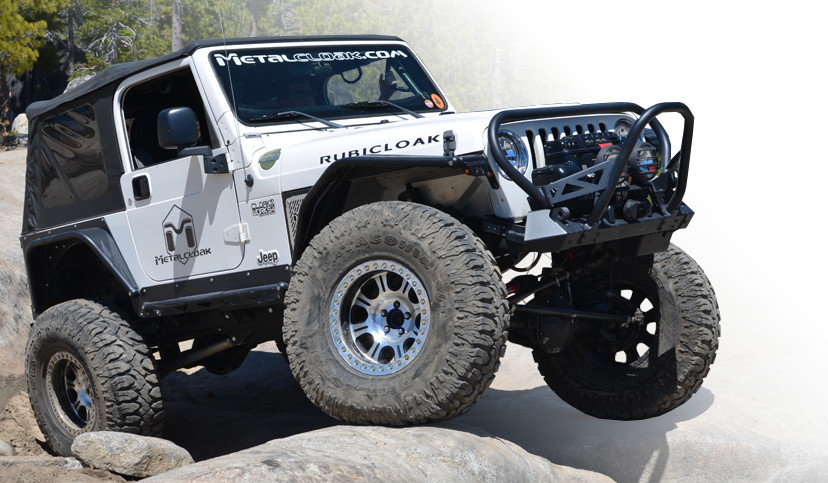 white MetalCloak Jeep TJ Wrangler on rock trail