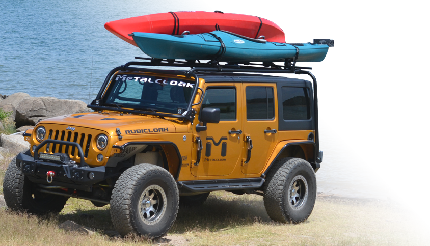 Gold Metalcloak JK with Kayaks on a Roof Rack by Lake